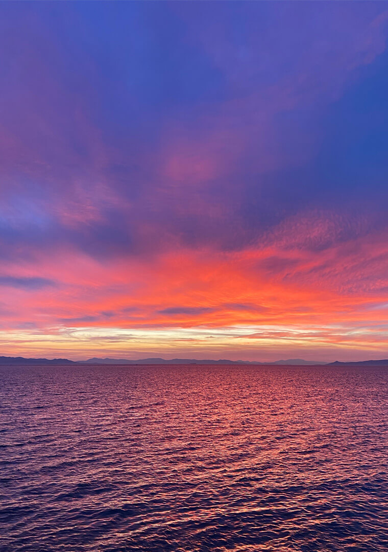 View of sea with red sunset in horizon.