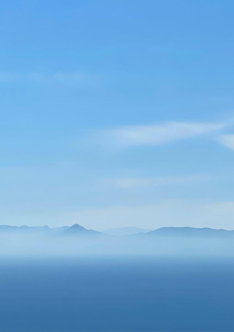 Blue misty horizon with mountains.