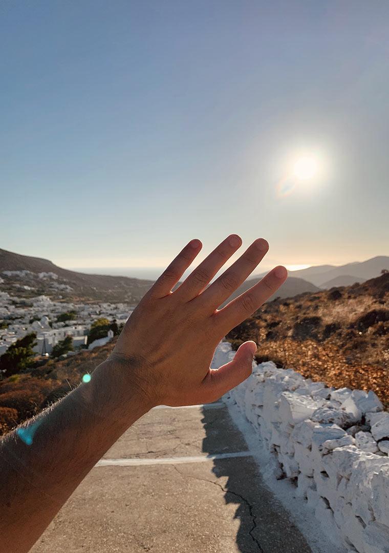 A hand against the sun.