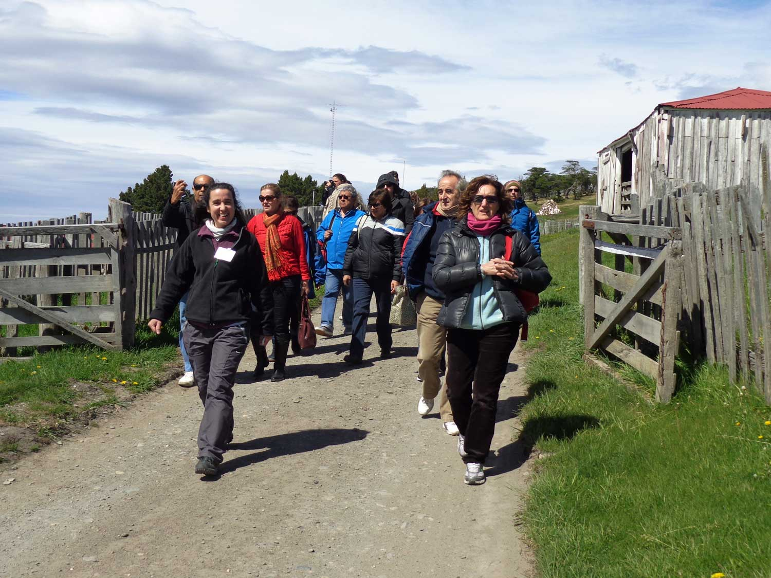 Group of people following their tour guide during one of the activities at Estancia Harberton.
