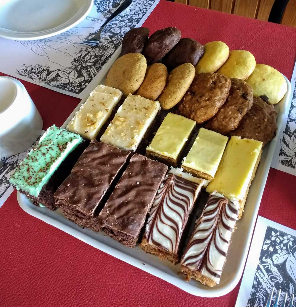 Variety of home baked cakes and cookies.