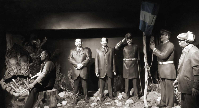 Thomas Bridges izando la bandera Argentina por primera vez en Ushuaia.