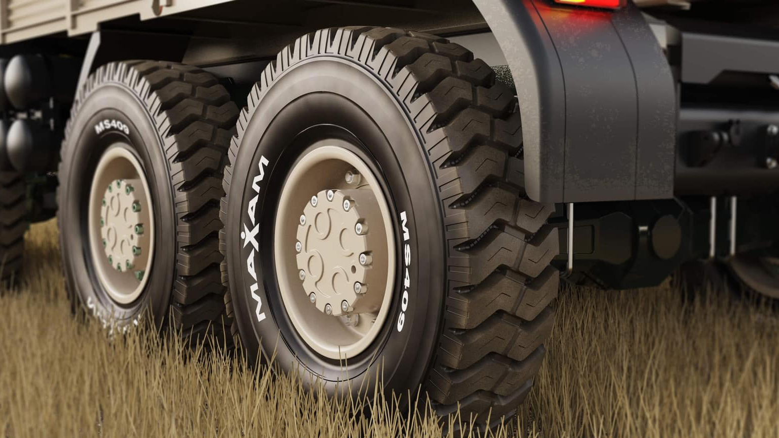 Maxam Tires Render in-context on grass