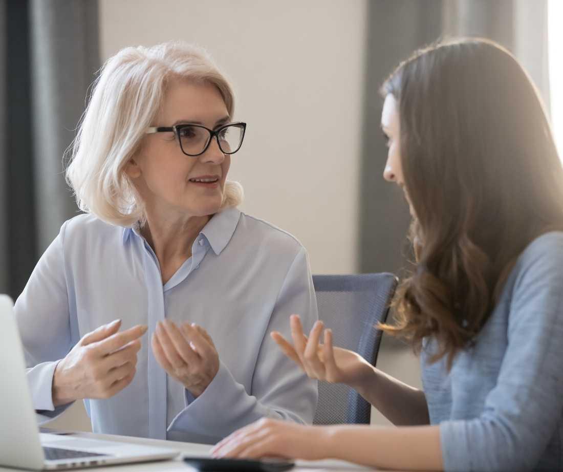 two-women-talking-media-buying