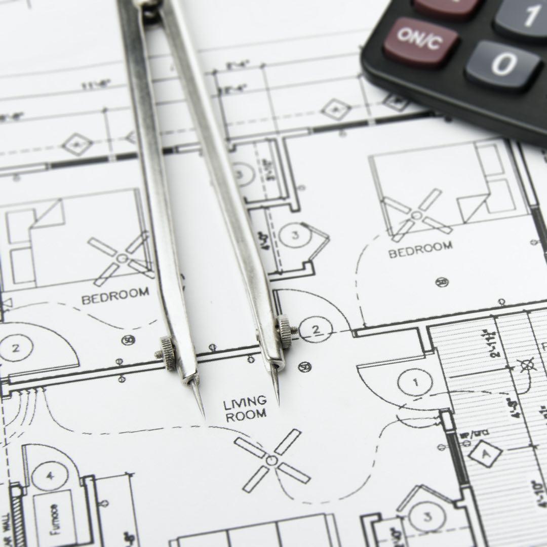 Blueprints and calculator to prepare a construction estimate