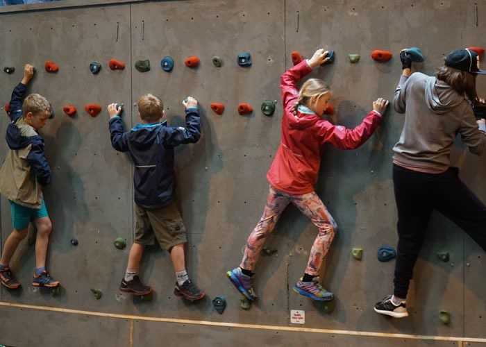 Trying out some fun problems on our traverse wall