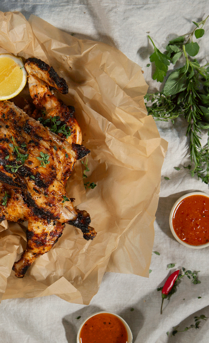 THE CHAR ROTISSERIE CHICKEN WITH HOT SAUCE AND LEMON