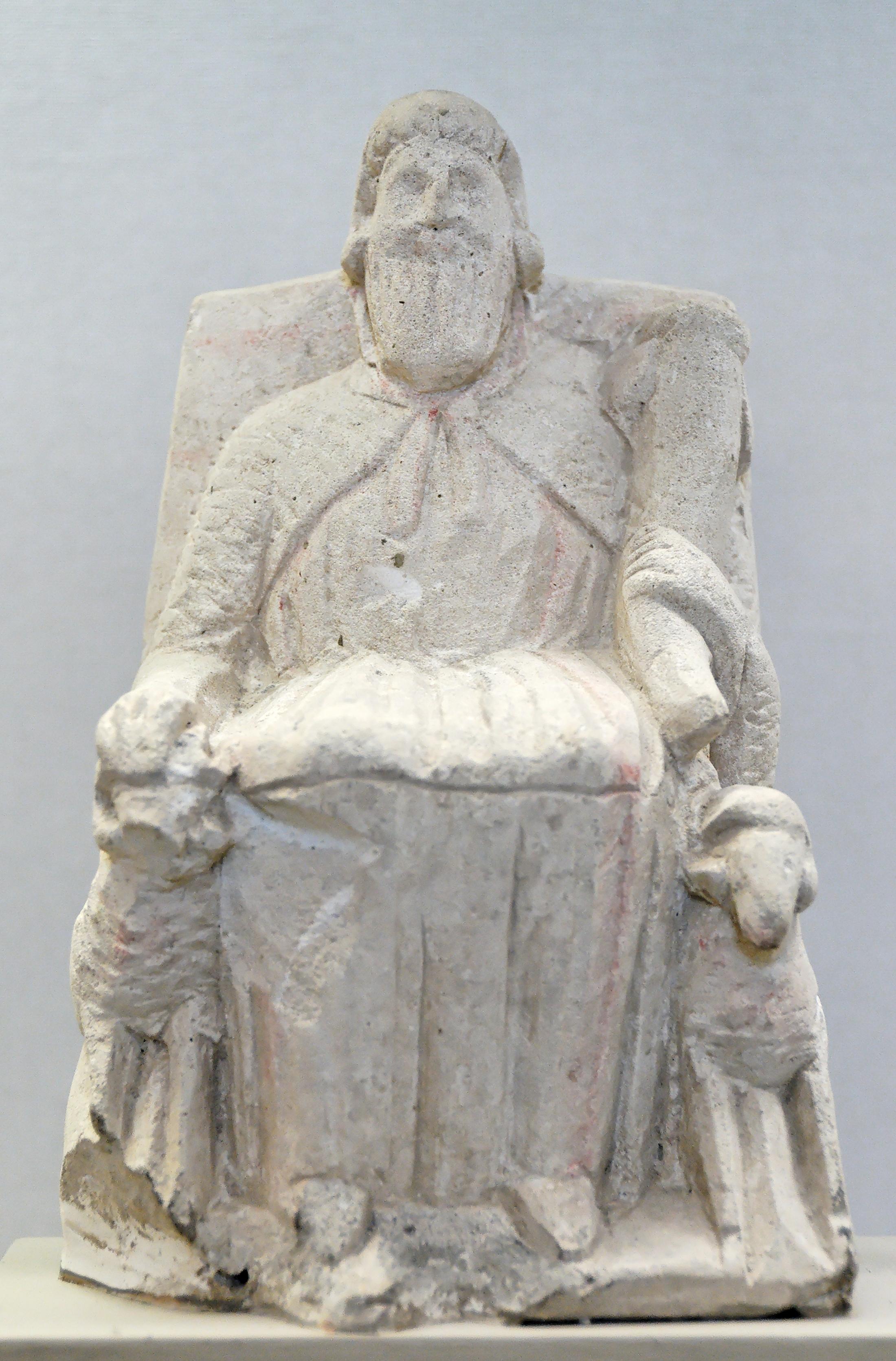 Sculpture Zeus-Ammon assis trône flanqué béliers calcaire