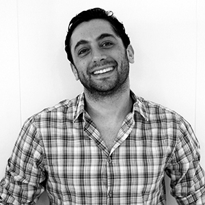 Our founder Diego wearing a plaid shirt and smiling