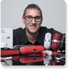 Photo of Zamir from iQualTech with his speaker business