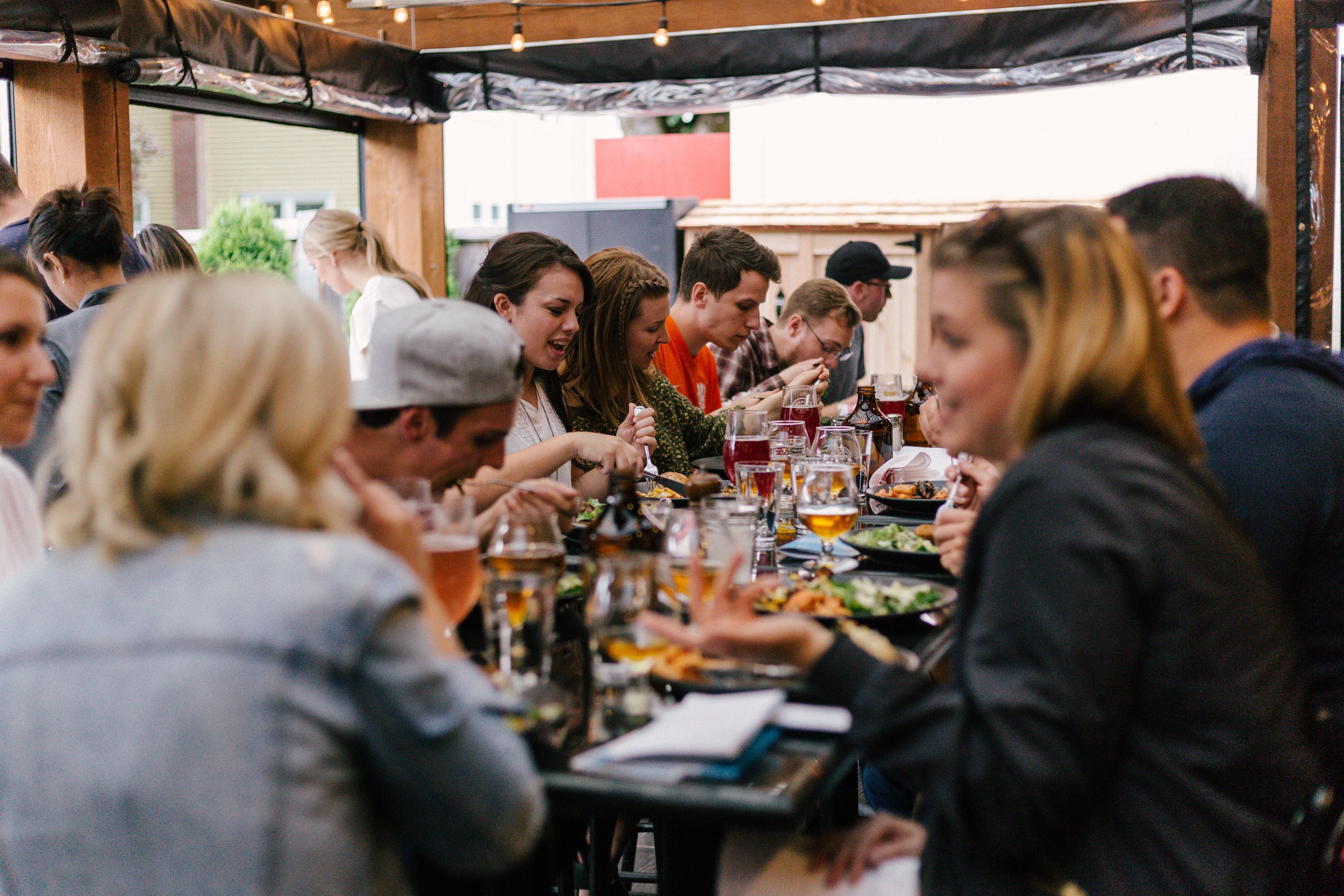 friends enjoying food together on an outdoor patio