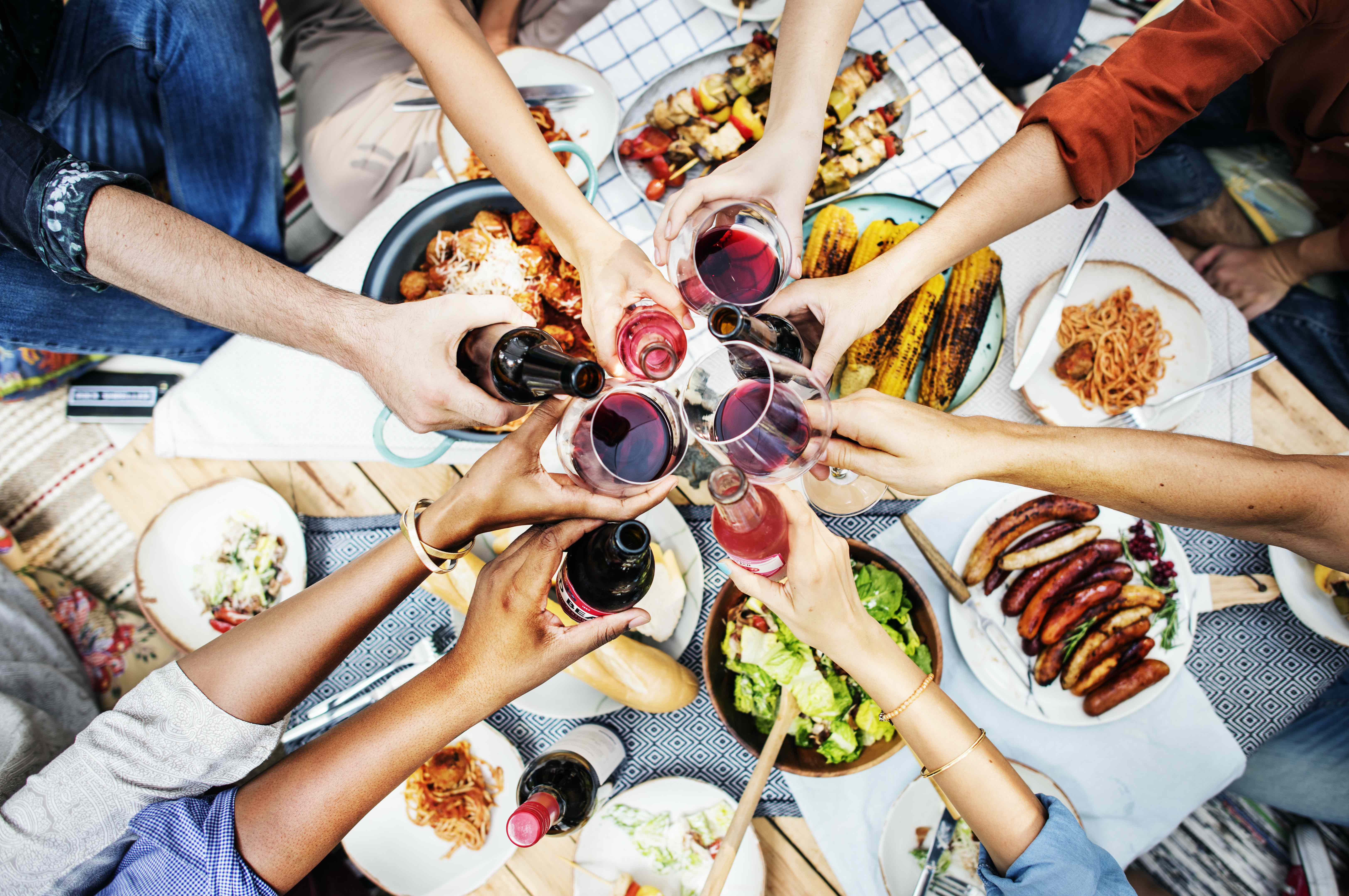 a diverse family sharing food and drinks