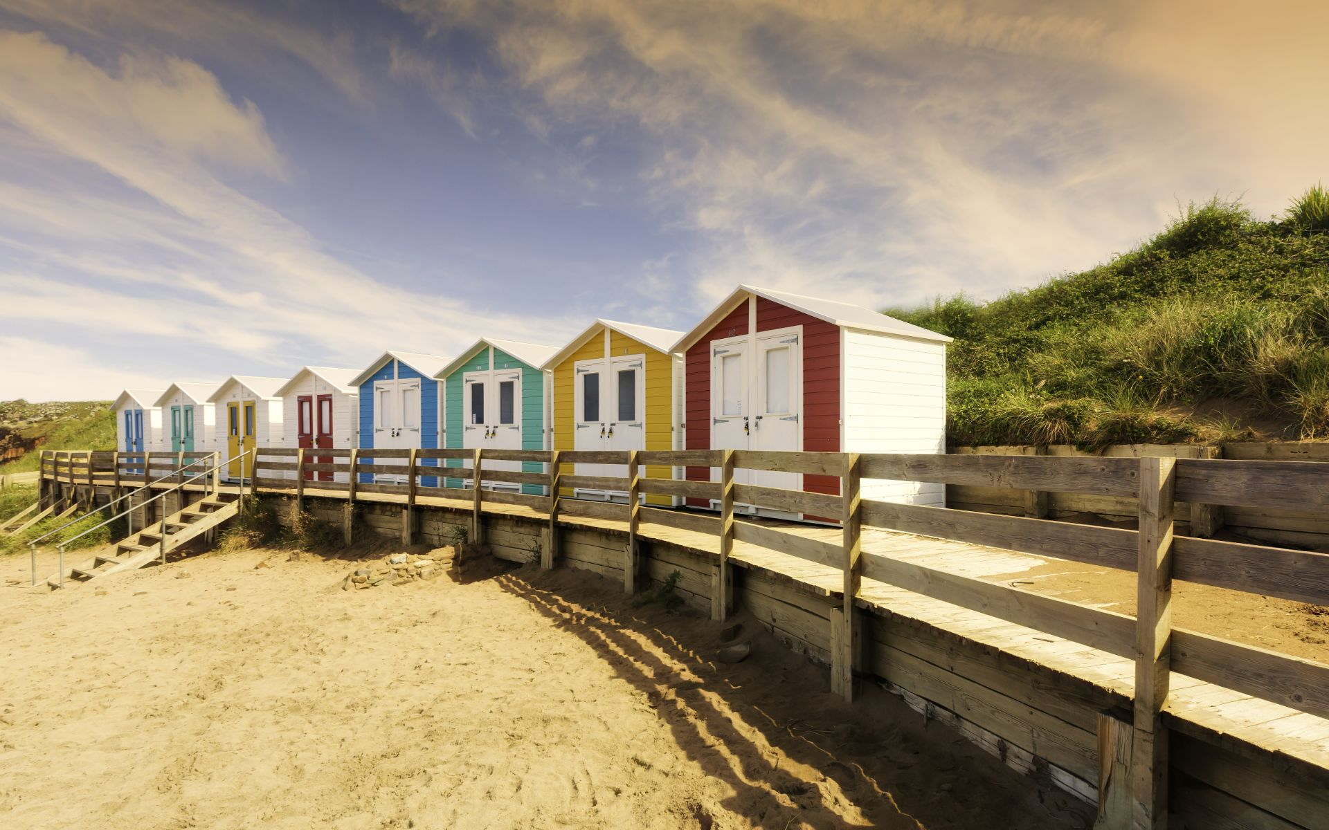 Colourful beach huts all in a row at Summerleaze Beach in Bude, Cornwall
