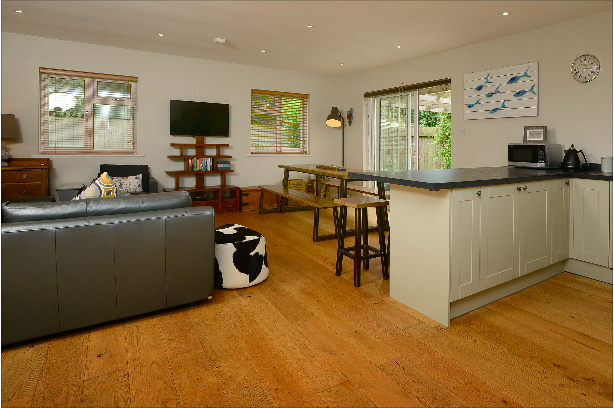Spacious lounge/kitchen/diner at Gwelmor self catering holiday home in Widemouth Bay