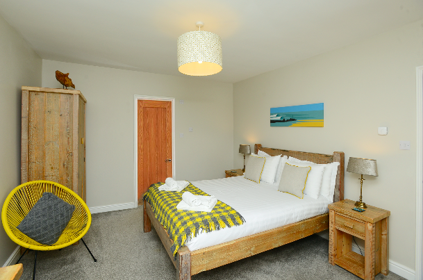 King size bedroom with ensuite shower room at Gwelmor self catering holiday home in Widemouth Bay