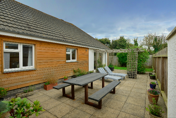 Enclosed rear garden at Gwelmor self catering holiday home in Widemouth Bay