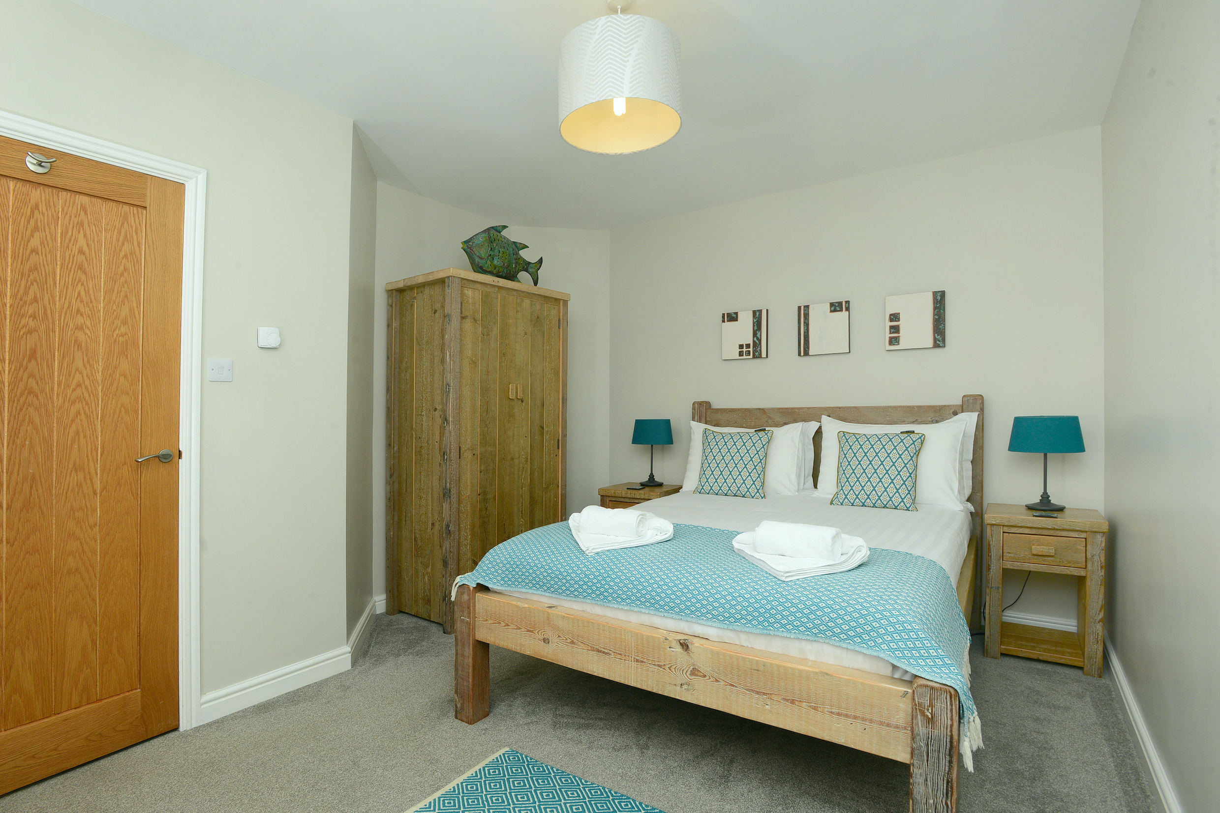 One of two king size bedrooms in Gwelmor dog-friendly self-catering holiday cottage in Widemouth Bay, north Cornwalle