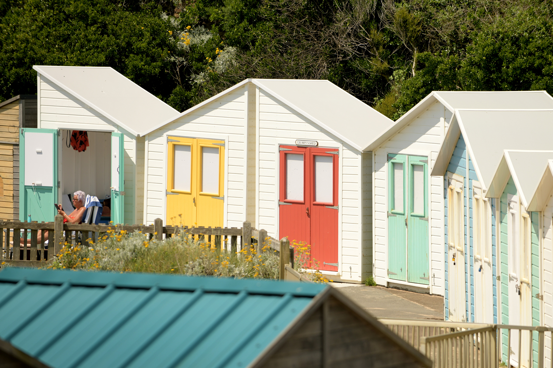 Colourful beach huts for hire at Summerleaze beach in Bude, north Cornwallc