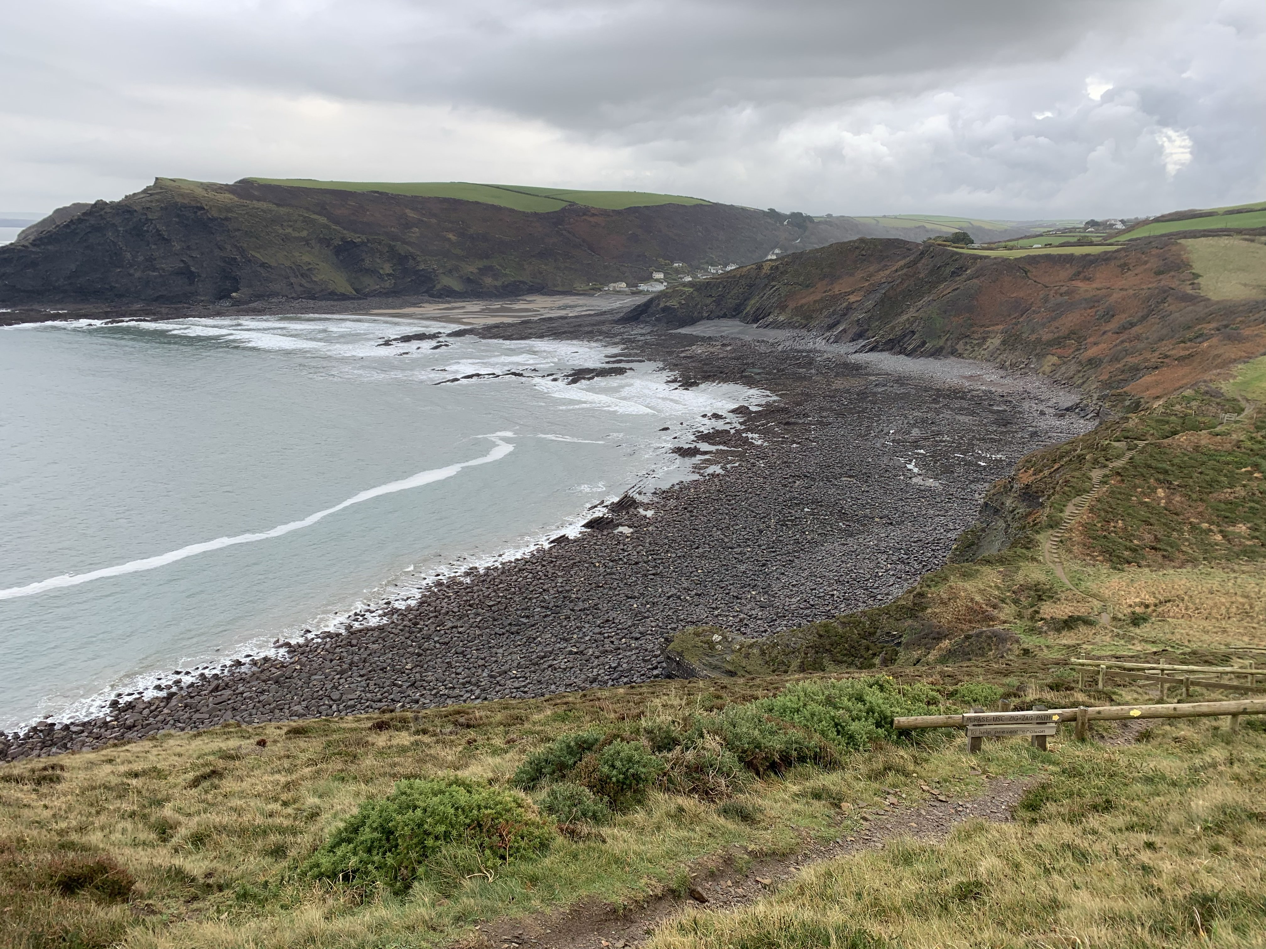 Looking back at Crackington Haven cove on The South West Coast Path walk to Boscastle