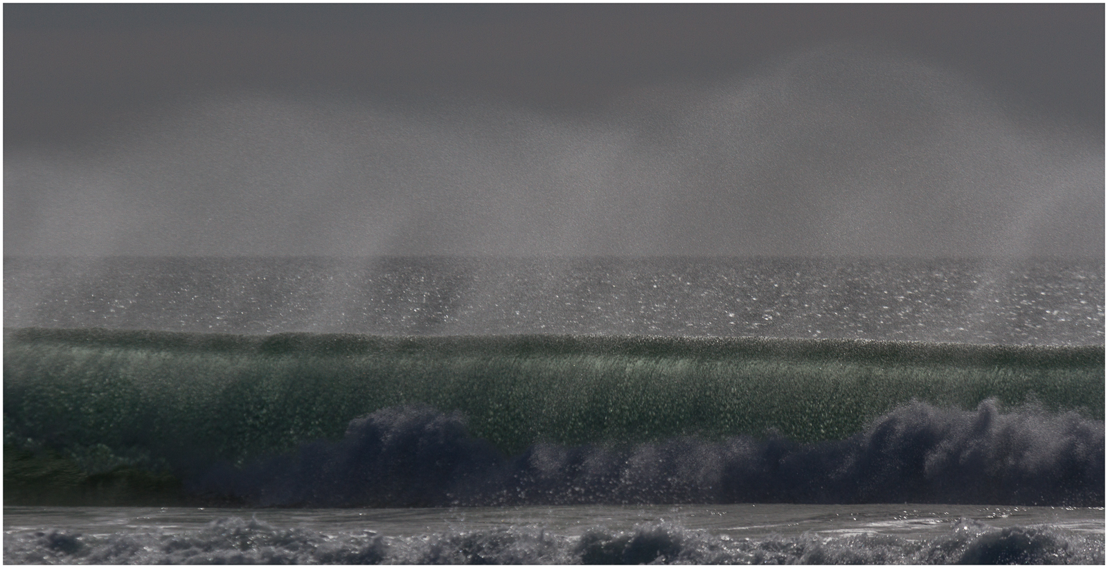 Spray from a wave is captured on film in Widemouth Bay. Photograph taken by a guest at Gwelmor self-catering holiday cottage in Widemouth Bay, North Cornwall
