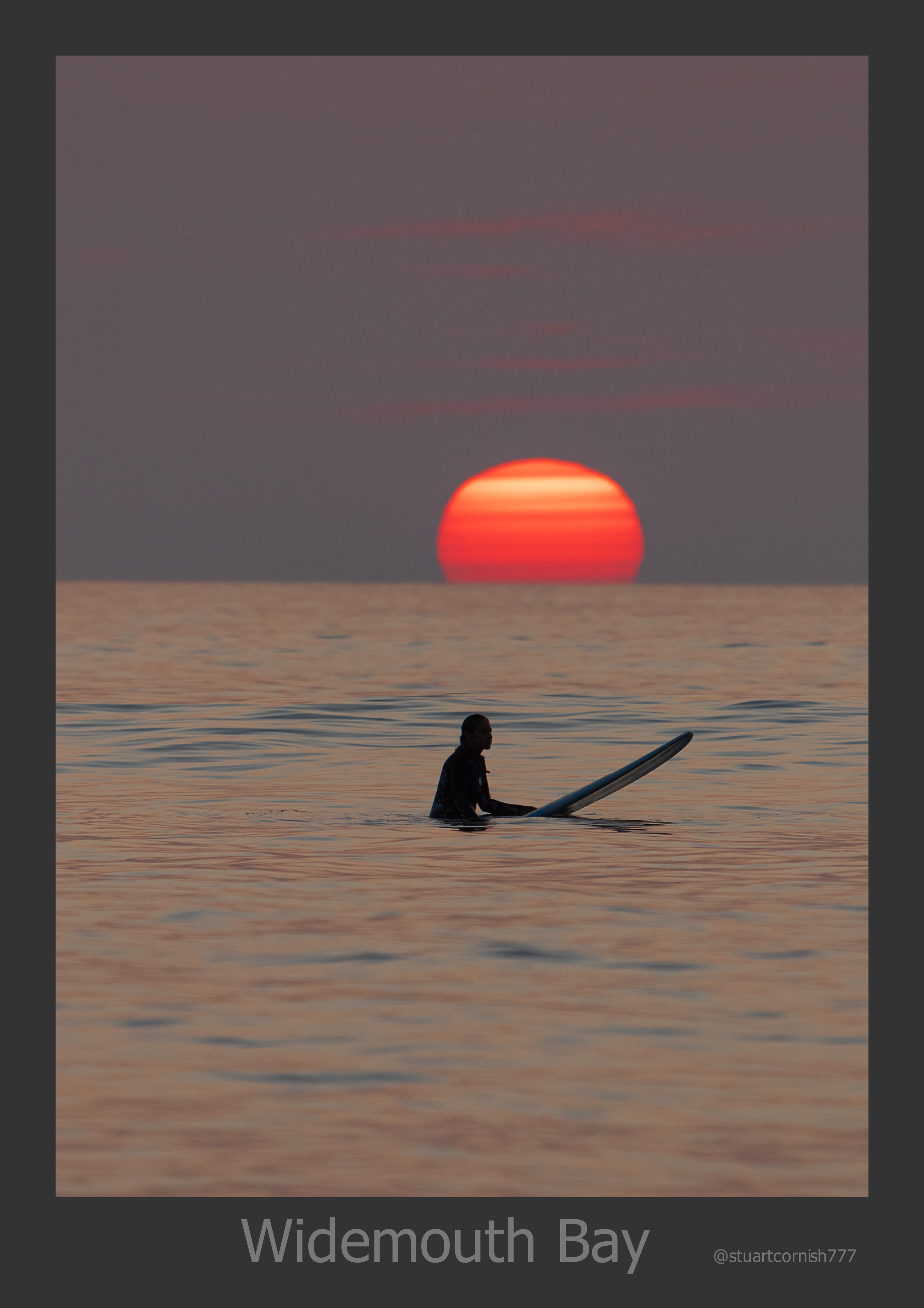 A solitary surfer is captured on camera in Widemouth Bay, north Cornwall by an amateur photographer whilst on holiday in Gwelmor self-catering and dog-friendly holiday cottage in north CornwallW