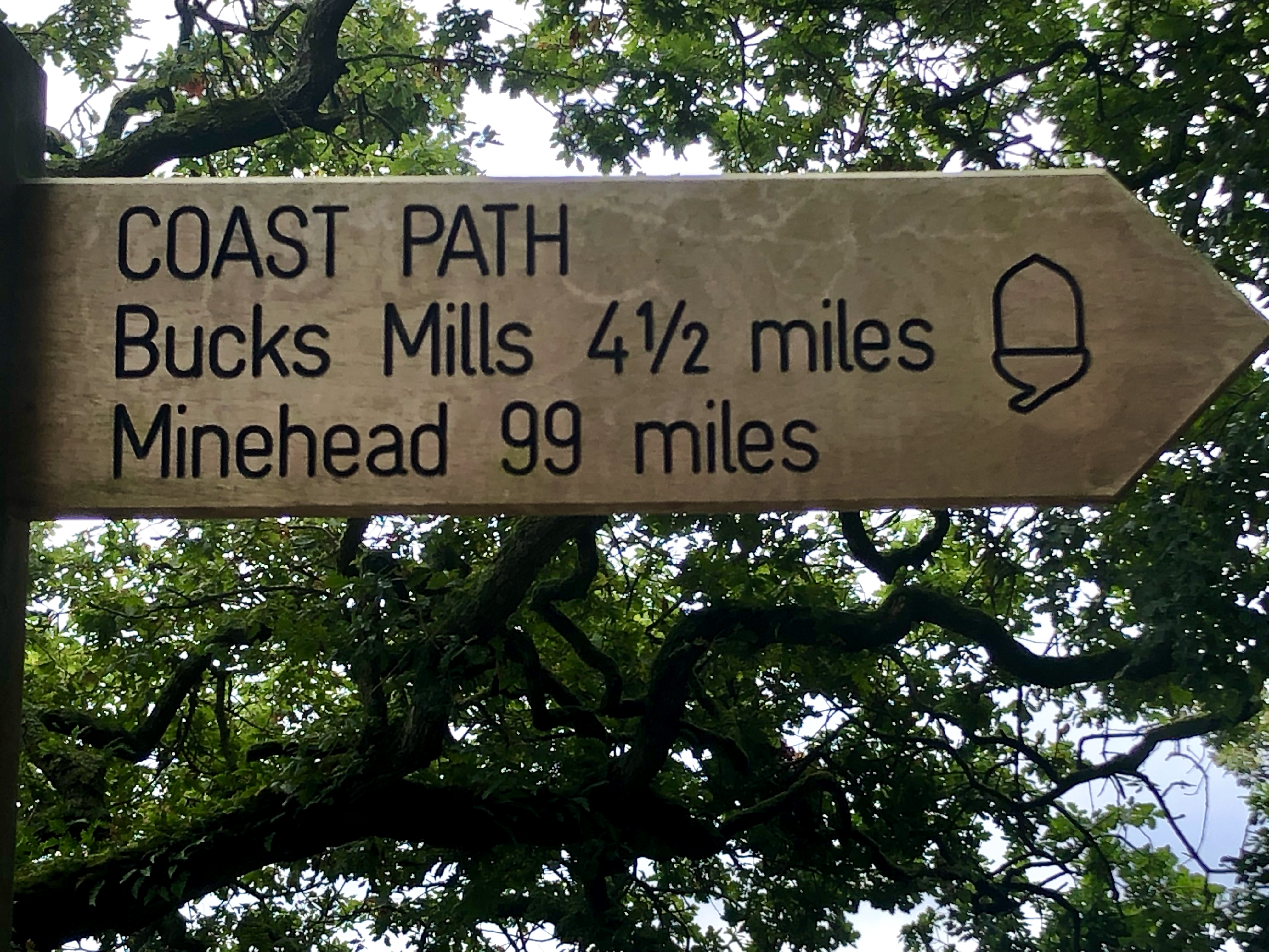 The South West Coast Path mile marker shows that we've ticked off almost 100 miles of our epic journey to walk the entire pathe