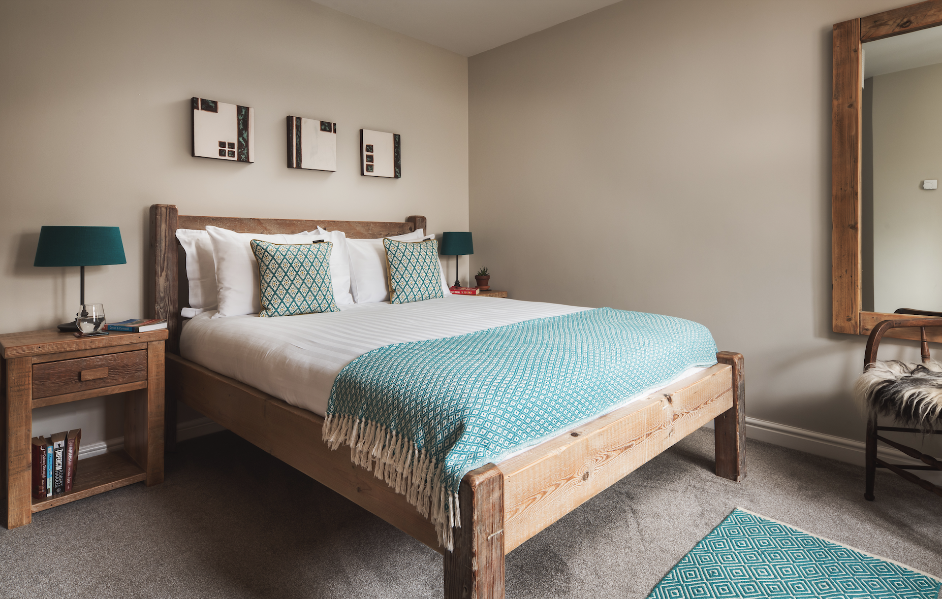 Second king size bedroom with brown and aquamarine theme at Gwlemor dog-friendly holiday cottage in Widemouth Bay, north Cornwall