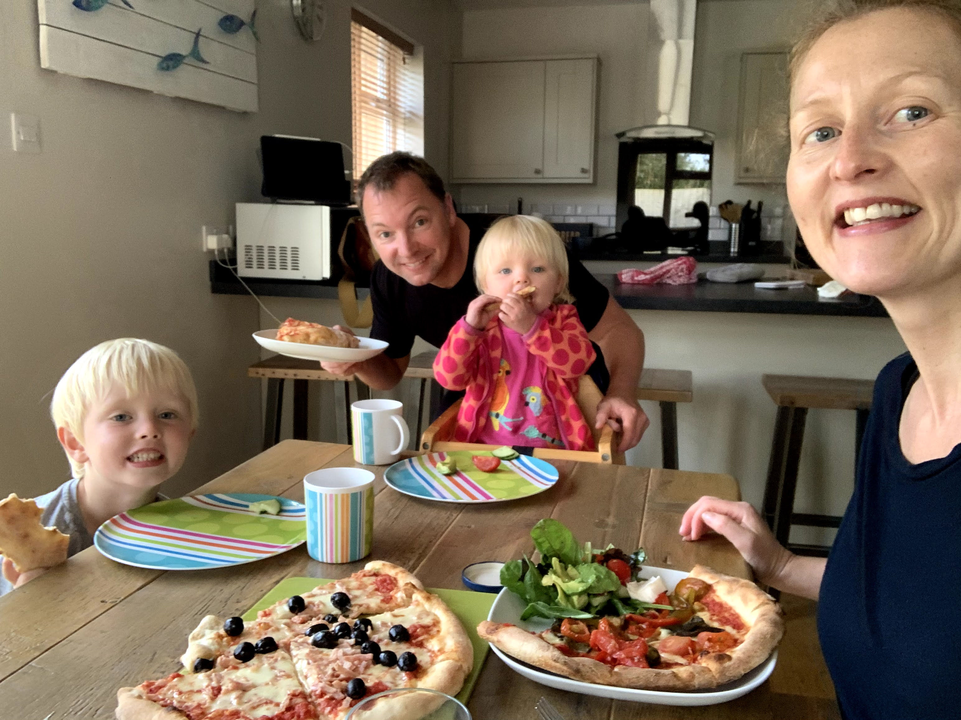 Family enjoy dinner at child-friendly Gwelmor self-catering holiday cottage in Widemouth Bay, north Cornwall