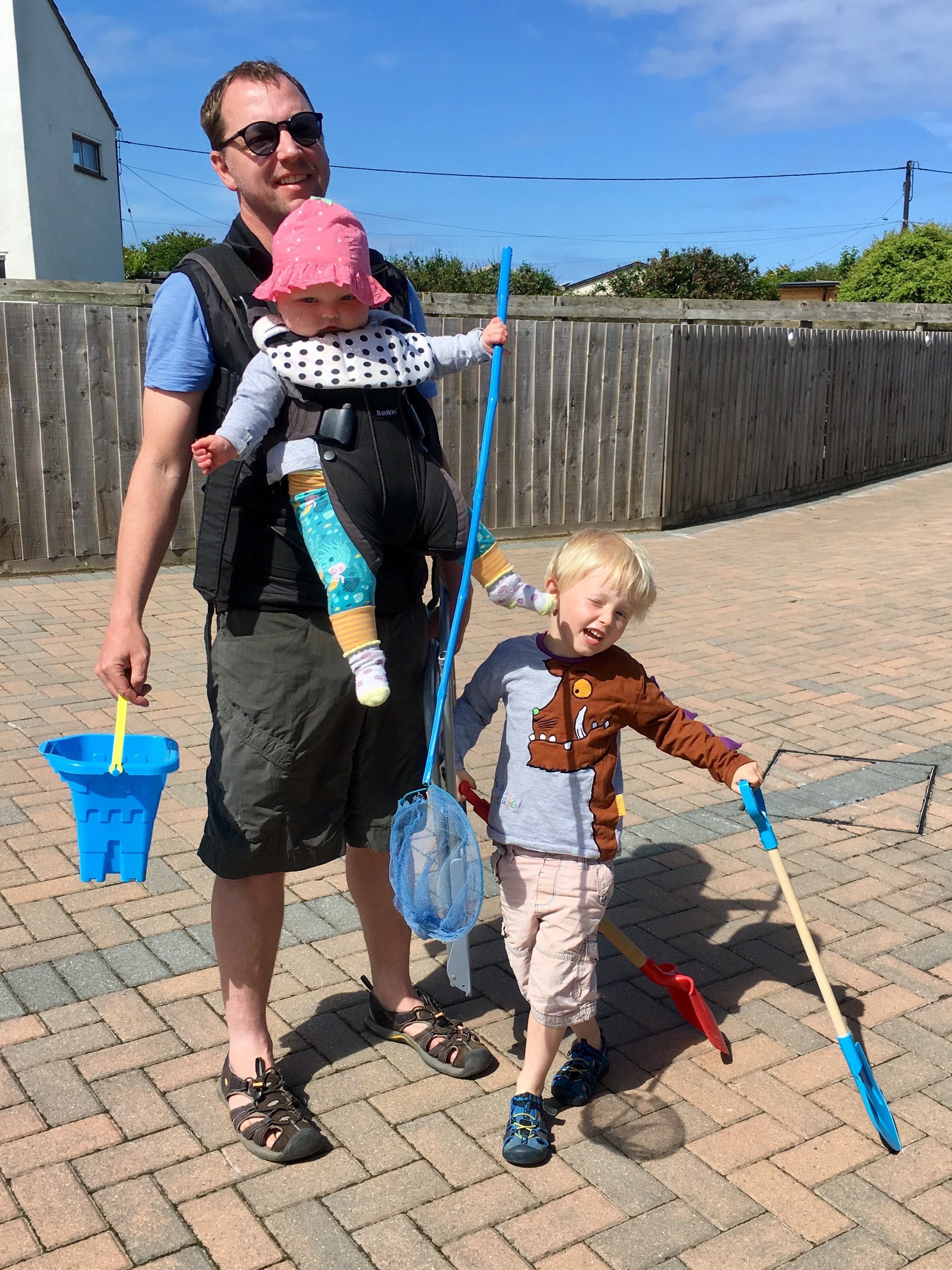 Family head to the beach armed with fishing rods, buckets and spades during their holiday at Gwelmor self catering cottage in north Cornwall