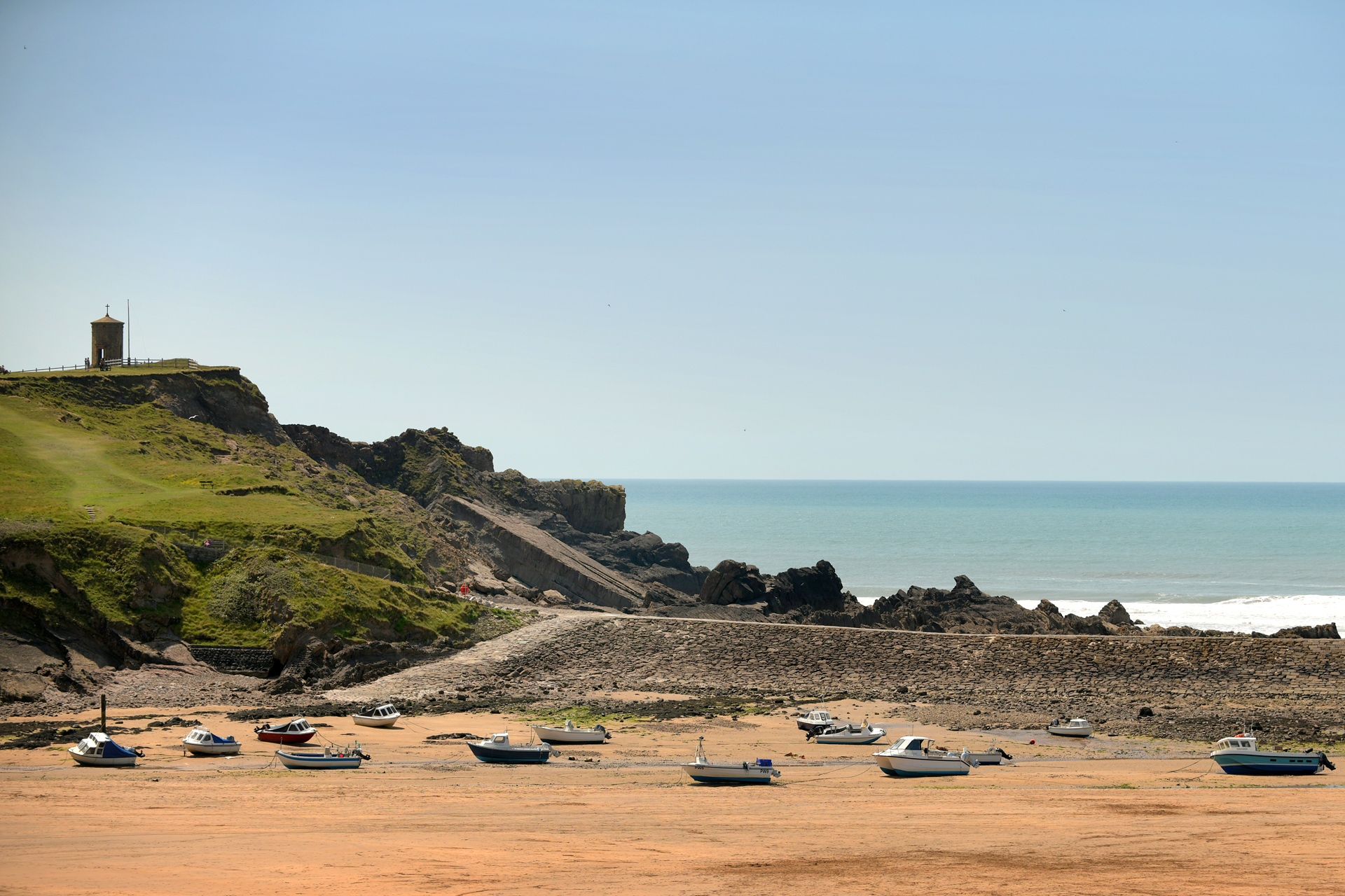 Boats at low tide on Summerleaze beach, Bude, north Cornwall