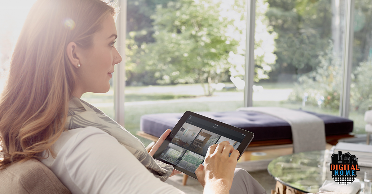 woman holding ipad with smart home app