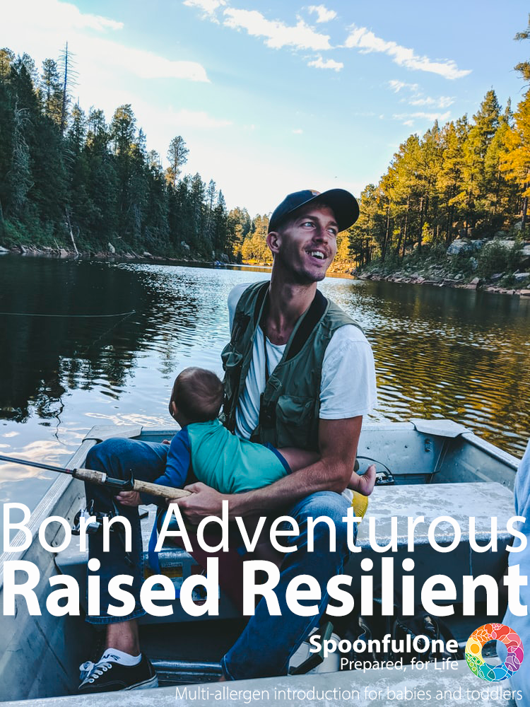 A young father in a fishing vest with a baseball cap and skinny jeans happily juggles a young toddler and a fishing rod while seated in a small metal boat on a calm narrow lake. Young mohter sitting on a surfboard in calm blue waters helping her infant child stand on the board. Copy reads: Born Adventurous, Raised Resilient. Spoonful one, Prepared for life.