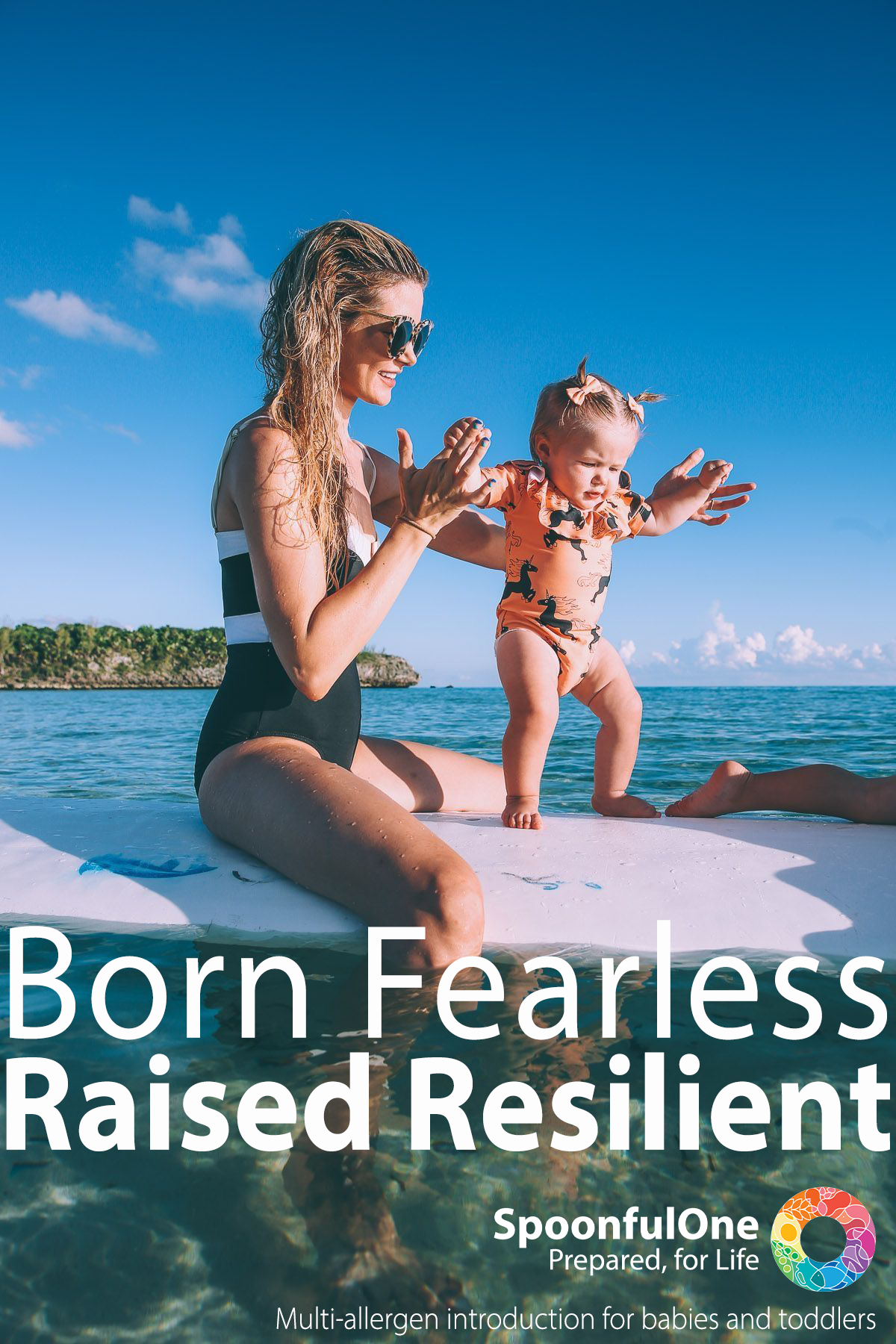 Young mohter sitting on a surfboard in calm blue waters helping her infant child stand on the board. Copy reads: Born Fearless, Raised Resilient. Spoonful one, Prepared for life.