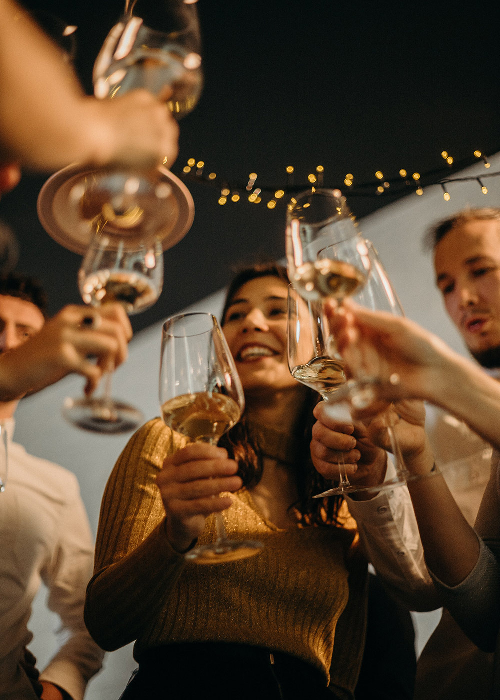 Couples raising their glasses for a toast.