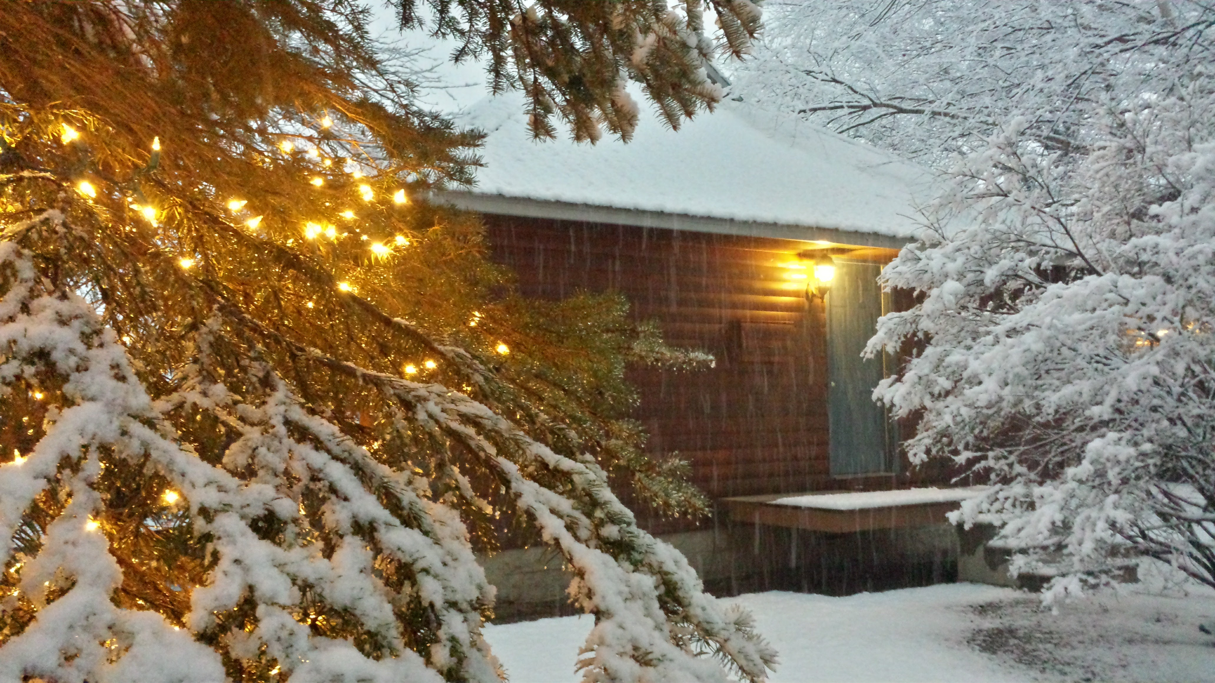 An exterior view of a cabin in the snow.