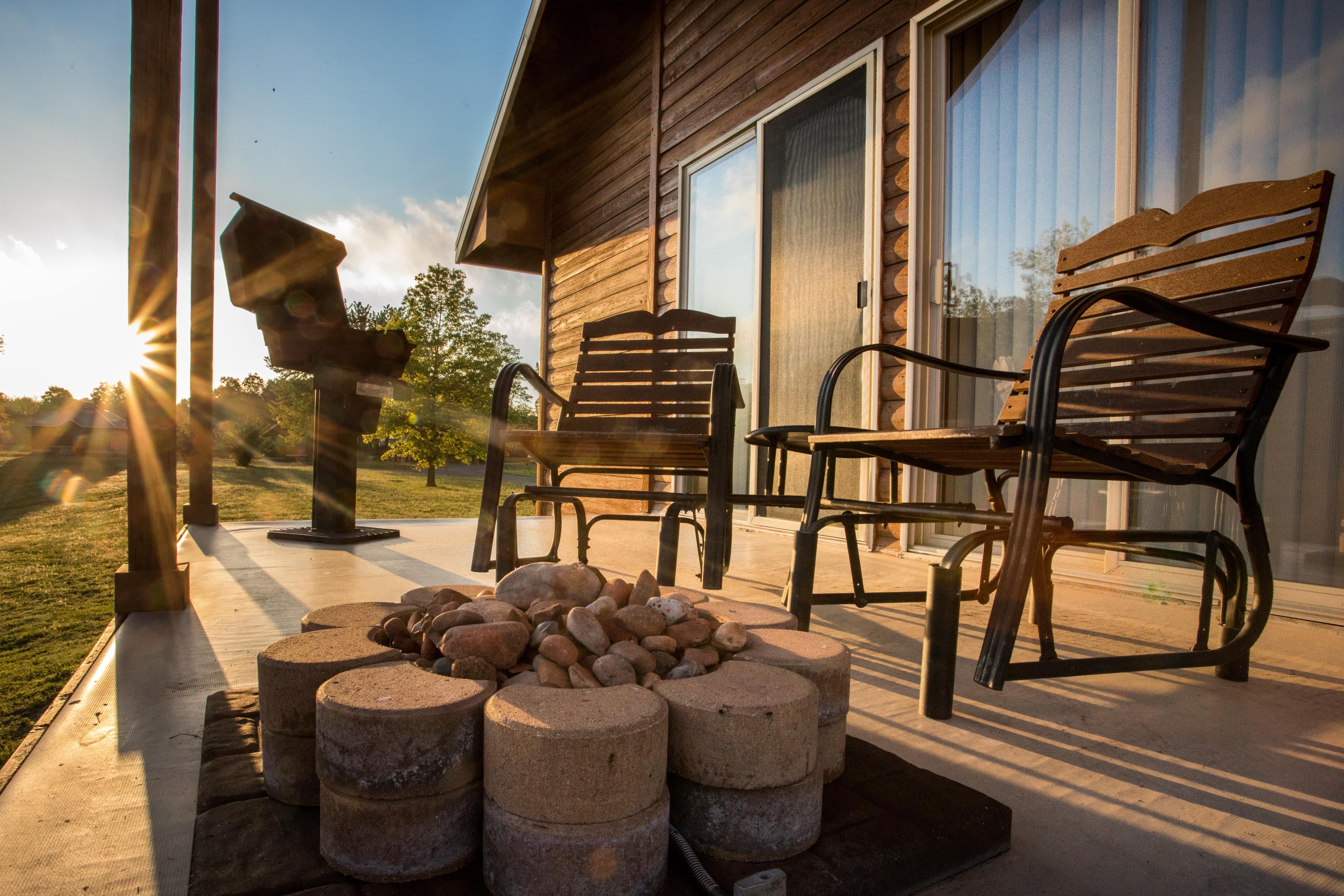cabin back porch campfire at serenity springs