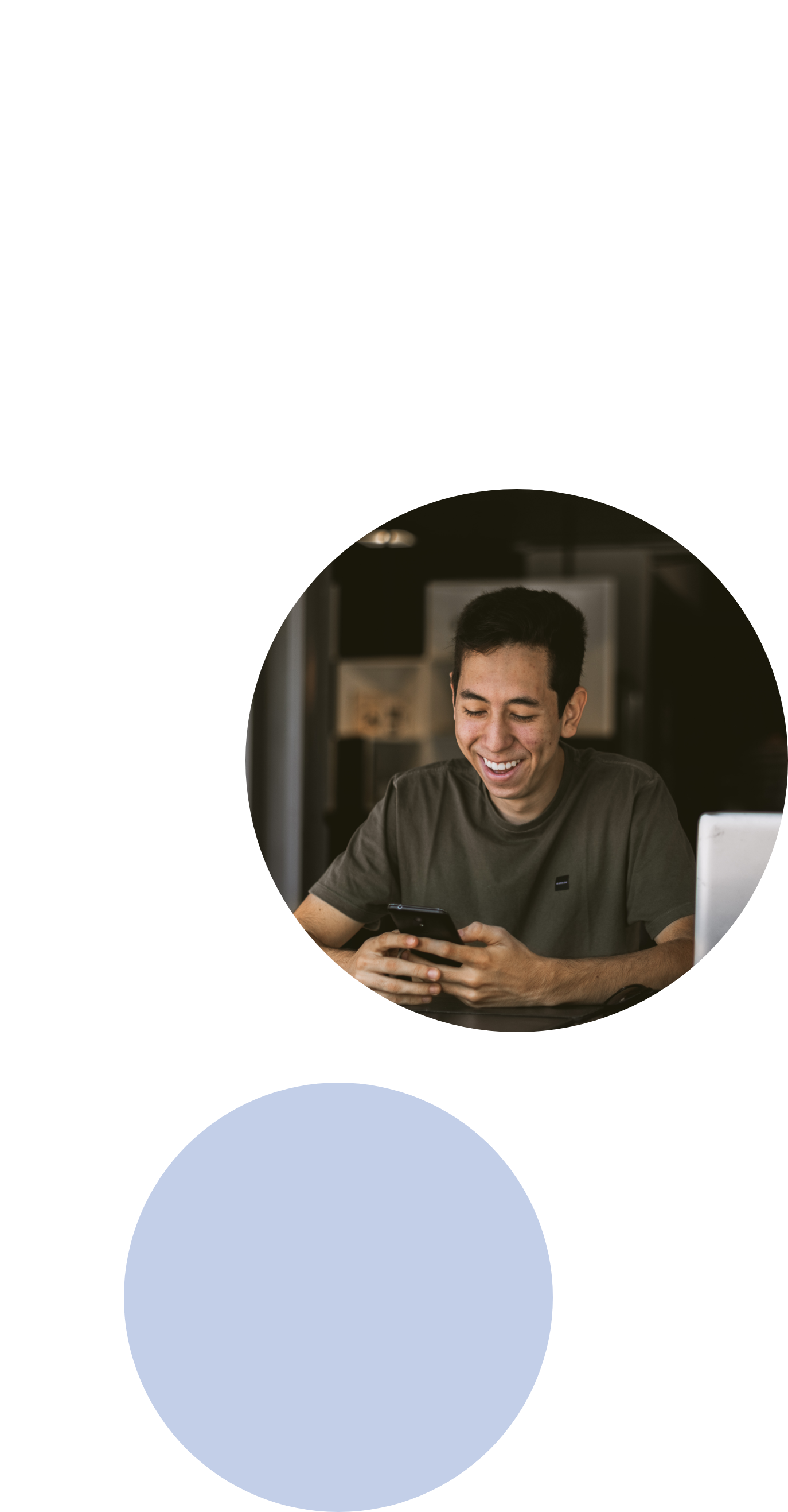 image of a man smiling while texting