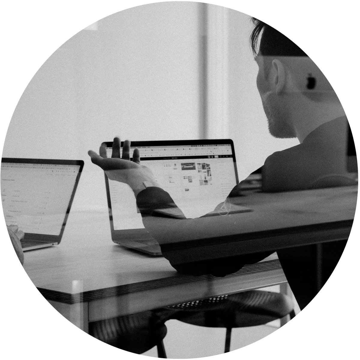 image of a man explaining through his laptop