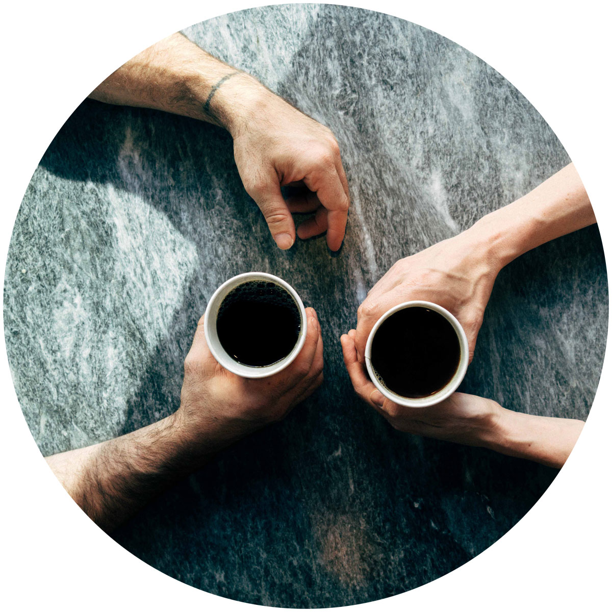 image of two people having coffee