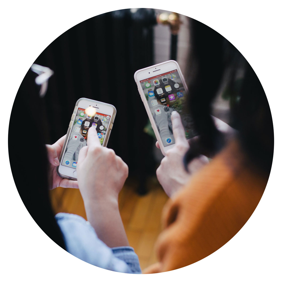 image of two people using mobile phones