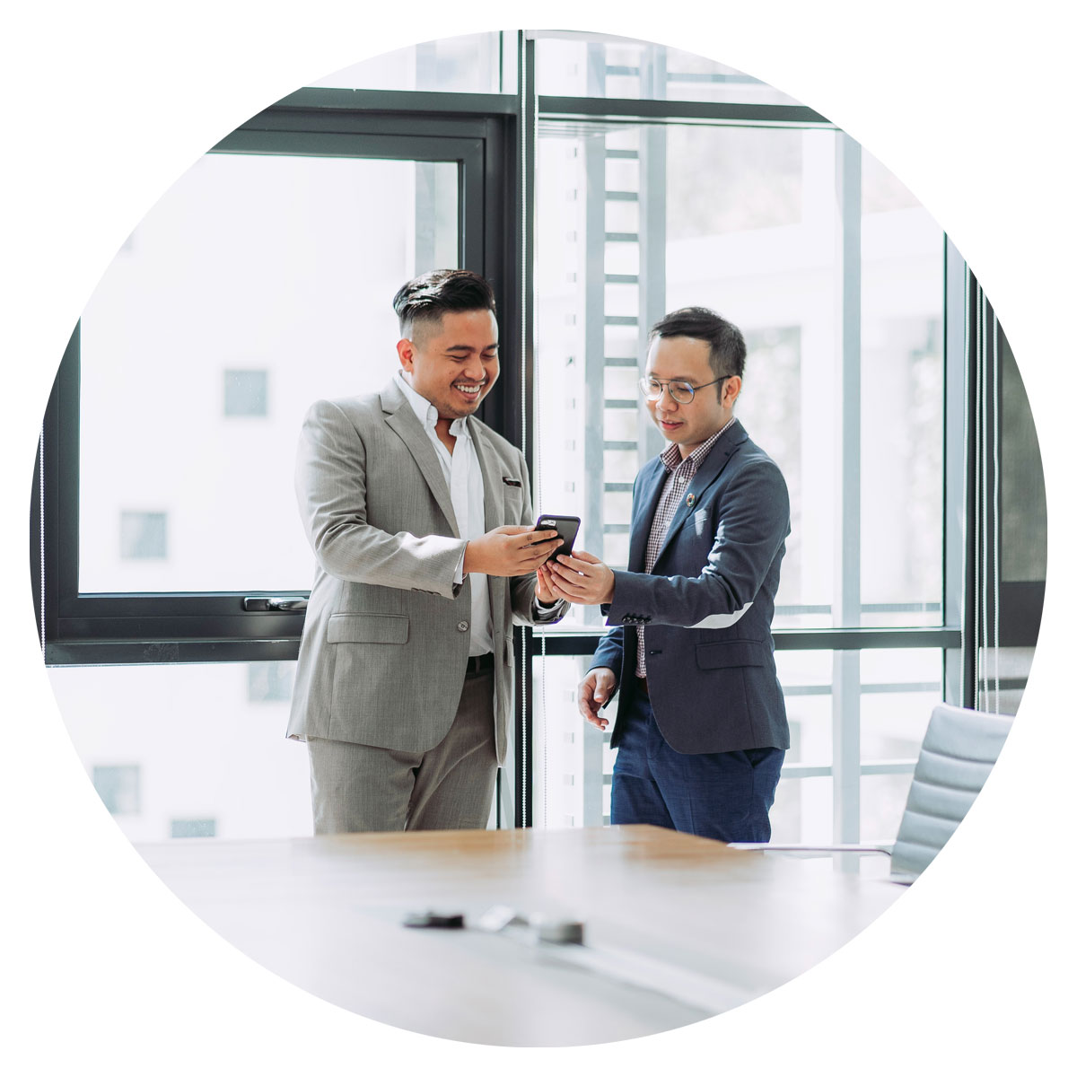 image of two men discussing