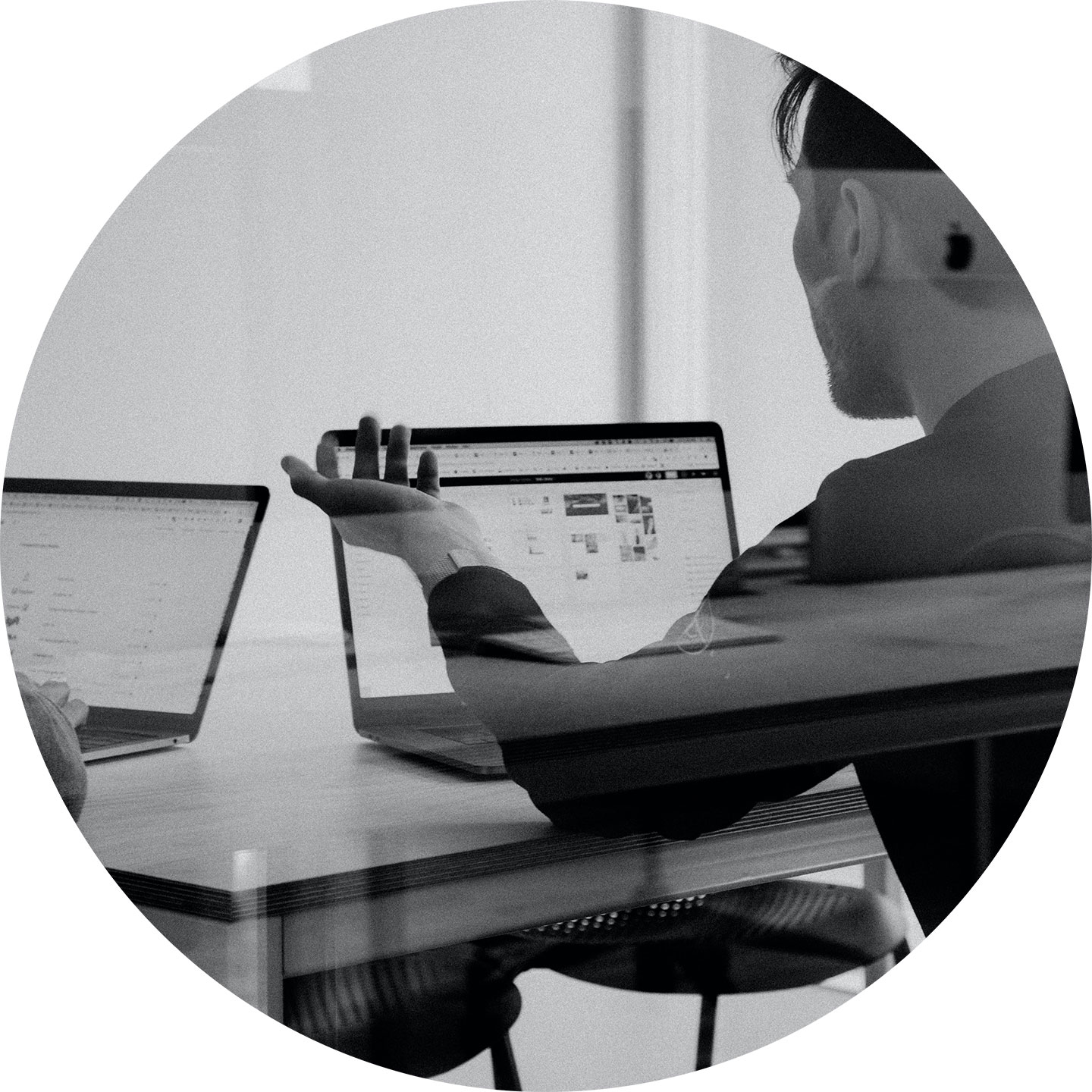 image of a male student facing a computer