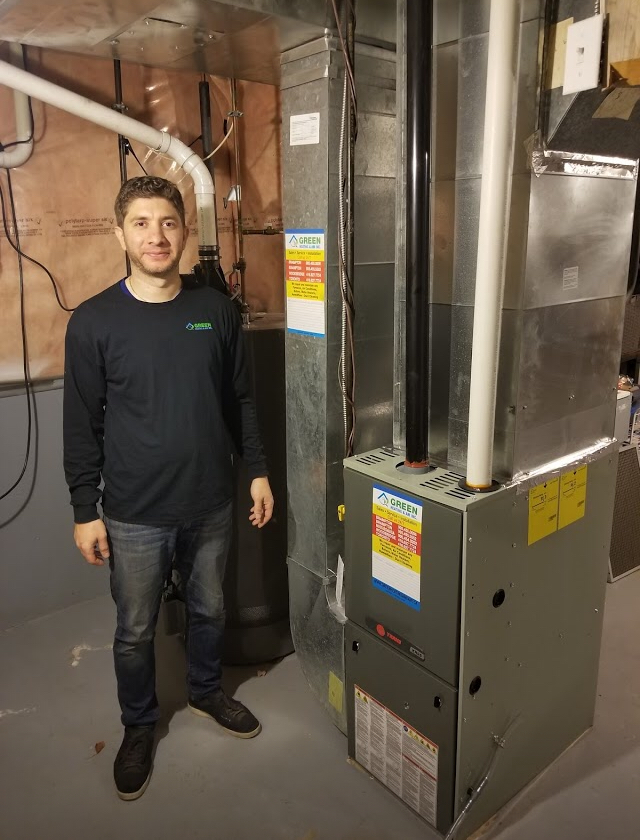 Green Heating and Air Technician installing Trane Furnace