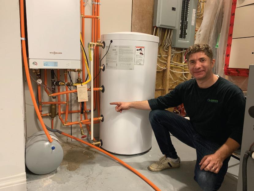 Green Heating and Air Technician installing Viessmann Boiler and Water Heater