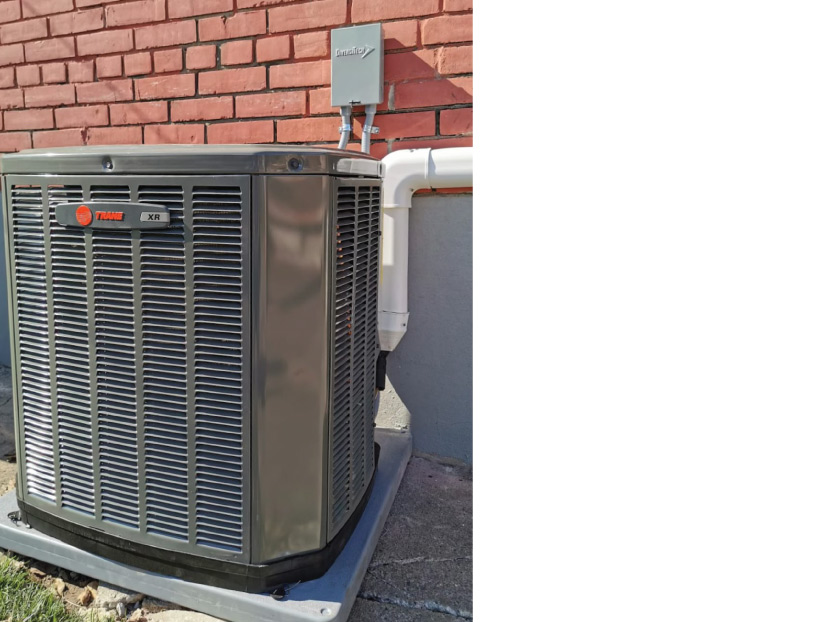 Greeen Heating and Air installing Trane air conditioning unit