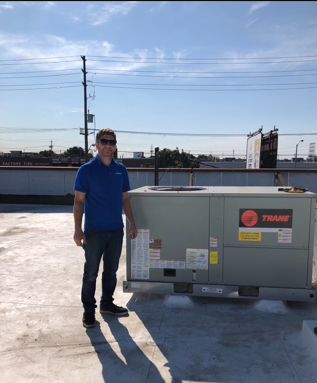 Green Heating and Air installing Commerical Trane Roof Top Heating and Cooling Unit