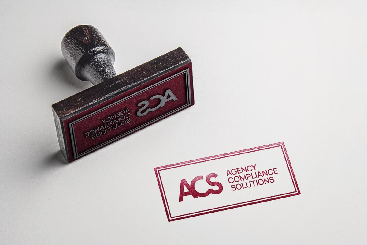 Agency Compliance Solutions logo rubber stamp mockup