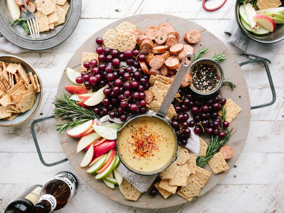 plate of nutritious food with apples grapes crackers