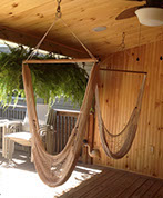 submitted by a customer - 2 hammock chairs hanging in their patio