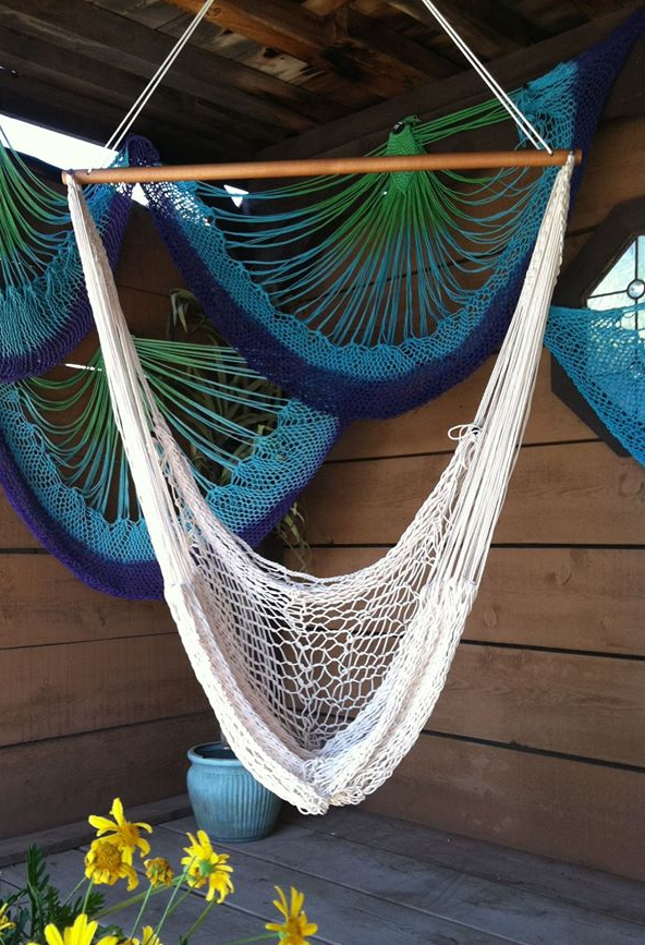White hammock chair hanging outside